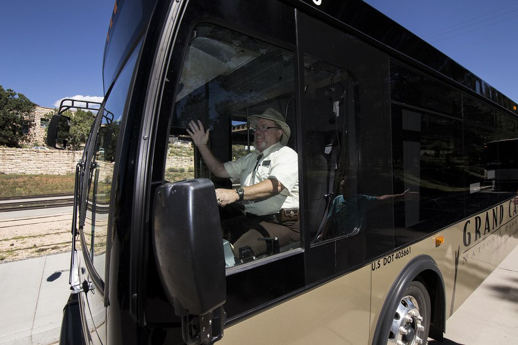 Tour guide and driver jeff waves as he sets out for a guided tour of the south rim
